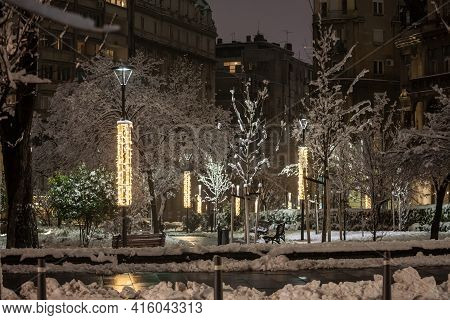 Empty Park Covered In Snow In Serbia, In Eastern Europe, In Belgrade, Serbia, With Public Lamps And