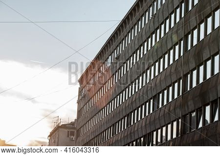 Abstract View At Dusk With A Flare Of An Old And Decaying Office And Warehouse Building In Belgrade,