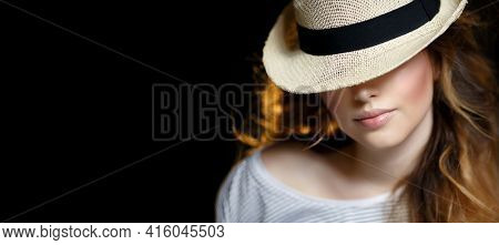 Young beautiful woman in a hat. A romantic beautiful stranger. The Modern Mystery Girl