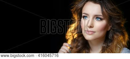 Model with long hair. Waves Curls Hairstyle.