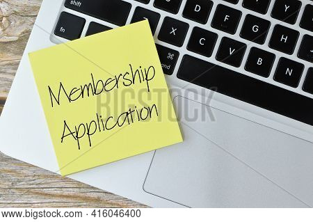 Top View Of Laptop And Memo Note Written With Membership Application