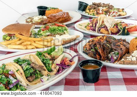 Restaurant Style Plates Of Delicious Mexican Food Dishes With A Variety Of Flavors And Textures For