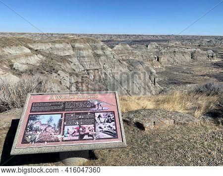 Dinosaur Provincial Park, Alberta, Canada - April 5th, 2021: A Sign Describing The History Of Dinosa