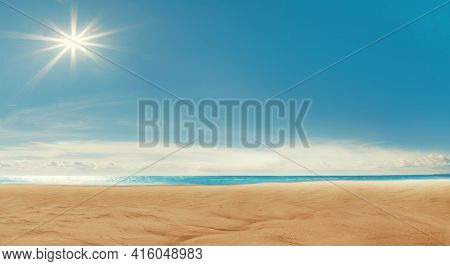 Beach background. Blue sky, the sea, the sun shining. Spa resort. Sand, ocean and rest. Vacation on a paradise island. Tourism. Sunlight. Travel.