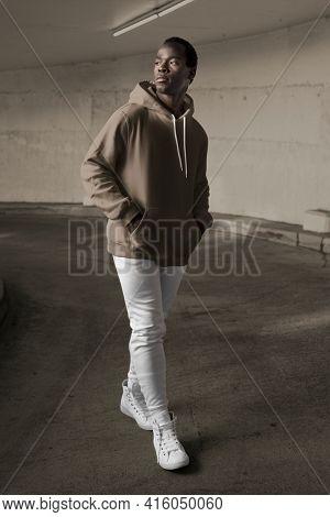 Man in gray hoodie streetwear men's apparel fashion
