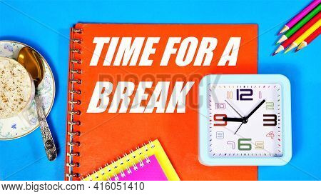 Time For A Break. The Inscription In The Planning Folder On The Background Of The Clock. Pausing An