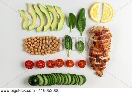 Cooked Ingredients For Dietary Salad With Chicken, Avocado, Cucumber, Tomato And Spinach