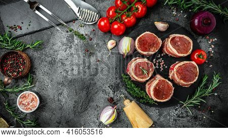 Fresh And Raw Meat. Sirloin Medallions Steaks Wrapped In Bacon Served On Old Meat Butcher, Ready To