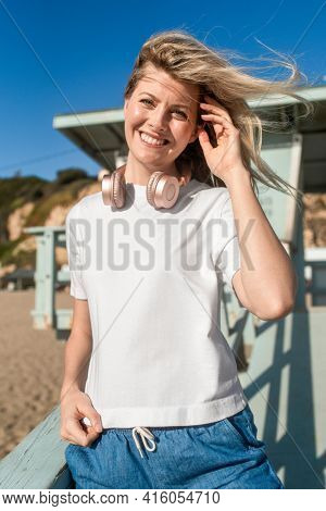 Blonde woman in white tee at the beach