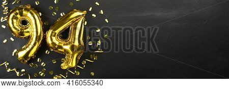 Golden Foil Balloon Number Ninety Four. Birthday Or Anniversary Card With The Inscription 94. Black