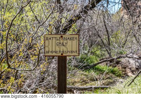 A Caution Signboard For Hikers In Boyce Thompson Arboretum, Arizona