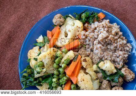 Buckwheat Porridge And Vegetables. Cauliflower And Carrots. Steamed Meatballs And Vegetables. Vegeta