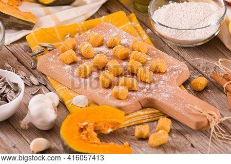 Raw Pumpkin Gnocchi With Potato On Cutting Board.