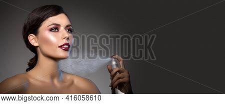 High-fashion Model Girl Beauty Woman high fashion Vogue Style Portrait beautiful fashionable Luxury lady sprinkles thermal water, perfume Stylish wet Makeup Make up Perfect skin eyes lips
