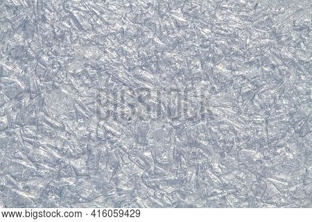 Smoothed Patterned Surface Of Ice Formed By Small Rounded Pieces Of Ice And Spots Of Frozen Water. T