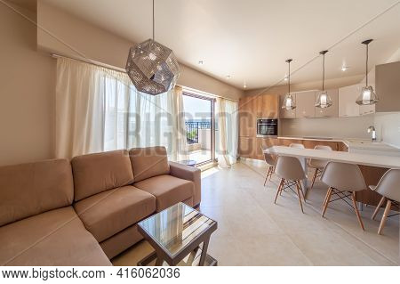 New Modern Living Room With Kitchen. New Home. Interior Photography.