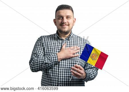 White Guy Holding A Flag Of Andorra And Holds His Hand On His Heart Isolated On A White Background W