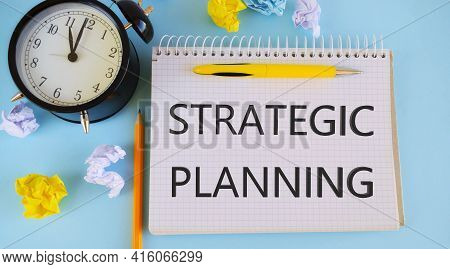 Hand Writing Strategic Planning. Business And Financial Concept.