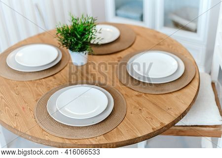 Table Set For Dinner In A Home Kitchen.
