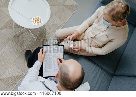 Home Doctor Prescribing A Medical Prescription To A Patient .