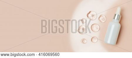 Pipette Serum Bottle Dose Of Fluid Hyaluronic Acid With Gel Drops On Neutral Beige Background. Cosme