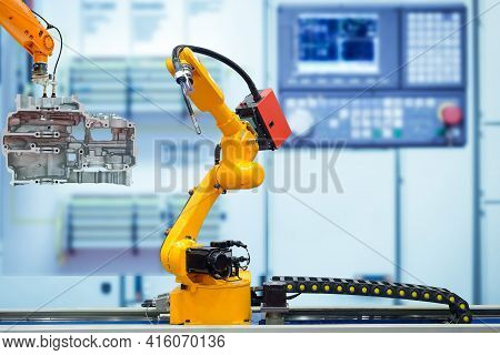 Moving Welding Robot And Robot Gripping Working With Engine Parts Of Motorbike On Blurred Smart Fact