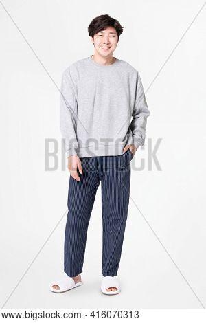 Man in gray sweater and pants sleepwear apparel full body