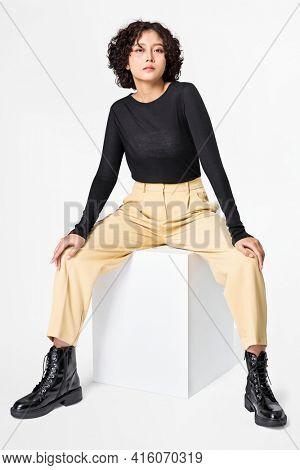 Stylish woman in black long sleeve tee and beige slacks casual wear fashion full body