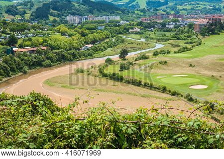 Aerial View To The River, Golf Field And City On A Beautiful Summer Day