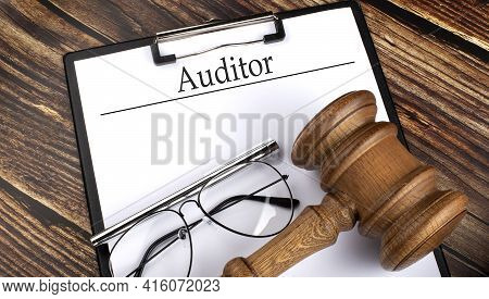 Paper With Auditor With Gavel, Pen And Glasses On Wooden Background
