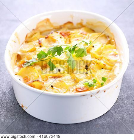 gratin- baked potato with cream and garlic