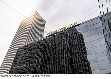Madrid, Spain - March 28, 2021: Moda Shopping Mall And Torre Picasso Skyscraper Against Sky With Sun