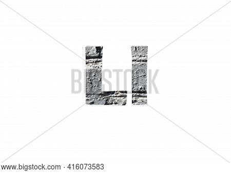 Gray Brick Background. Shot Through The Cut-out Silhouette Of The Letter L