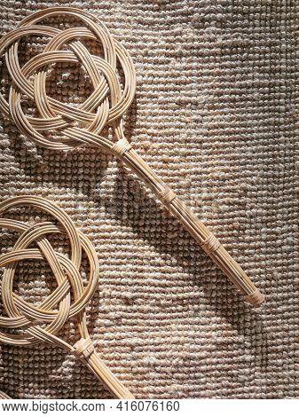 Carpet Beater Lays On A Jute Carpet