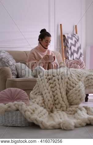 Beautiful Young Woman With Cup Of Drink Relaxing At Home. Cozy Atmosphere
