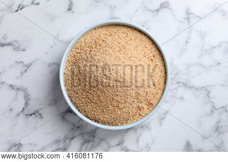 Fresh Breadcrumbs In Bowl On White Marble Table, Top View