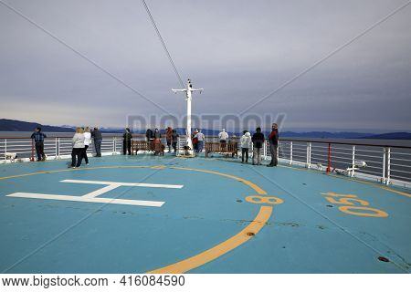 Strait Point, Alaska / Usa - August 15, 2019: Tourists Look The Sea From Helicopter Deck On Cruise S