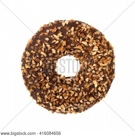 Donut With Frosted Chocolate Glaze And Nuts Sprinkles Isolated On White Background. One Round Chocol