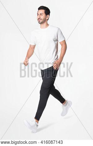 Man running in white t-shirt sportswear apparel full body