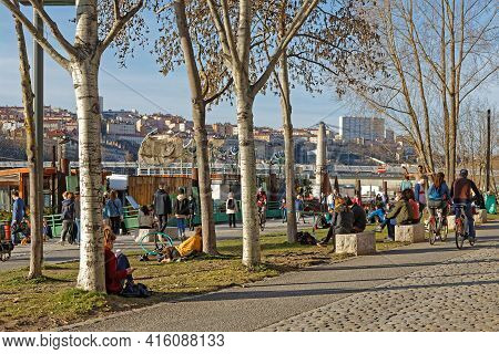 Lyon, France, February 19, 2021 : People Of Lyon Have A Walk In The Open Air On The Quays Of The Rhô