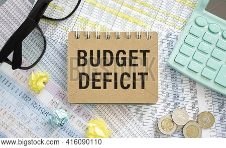 Notepad With Text Budget Deficit. Diagram And White Background