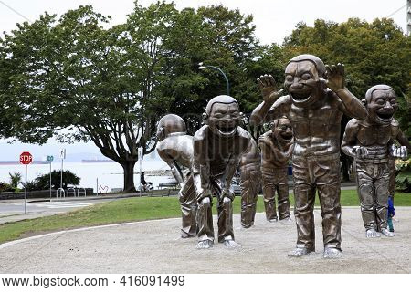 Vancouver, America - August 18, 2019: Giant Laughing Statues To Stay In English Bay, Vancouver, Amer