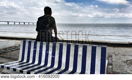 Lisbon, Portugal- June 4, 2018: Woman Looking At The Horizon In The River Tagus In A Cloudy Day Of S