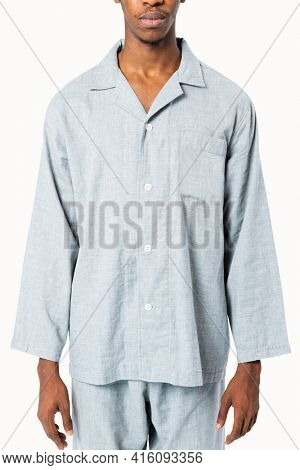 Man in blue pajamas nightwear studio shoot