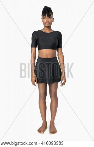 Woman in two-pieces black swimsuit summer apparel full body