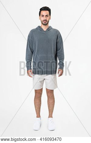 Trendy man in gray hoodie street fashion full body