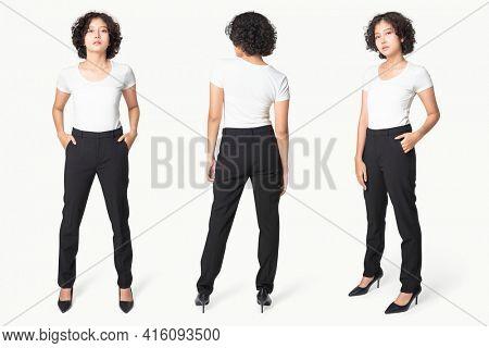 Woman in black slack pants and white tee full body
