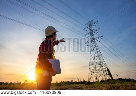 High Voltage, Construction Electrical Engineer Or Technician Standing And Watching At The Worker Che