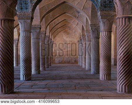 Shiraz, Iran-04.17.2019:s Ymmetrical Spiral Columns In A Hall Of Vakil Mosque In Shiraz, Iran.