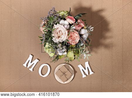 Festive Composition For Mothers Day With Flowers Bouquet, White Letters Mom, Diy Gift Box On Beige C